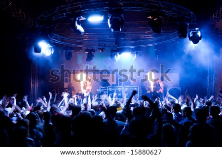 People dancing at the concert, fire show and music - stock photo