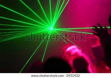 People Dancing at the Disco party with laser show - stock photo