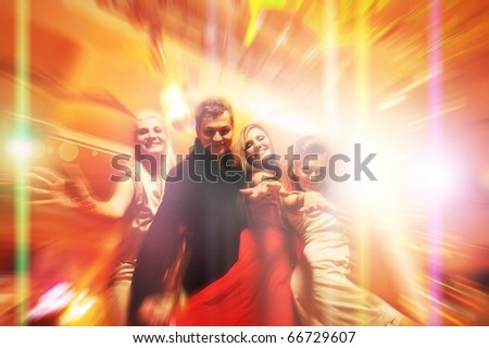 People dancing in the night club - stock photo