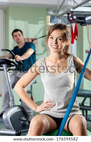 People doing different exercises in fitness center