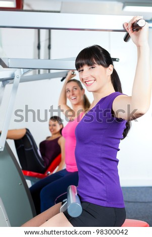 People doing strength or sports training in gym - stock photo
