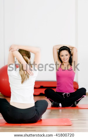 people doing yoga classes at the gym - stock photo