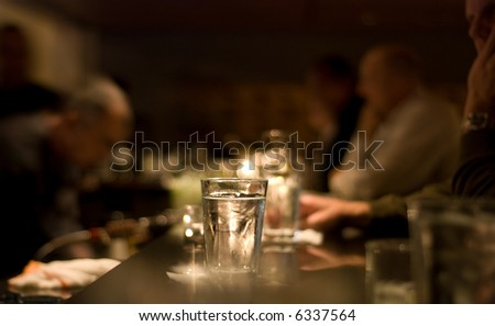 People drinking at a bar. Short depth of field.
