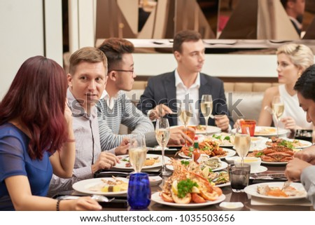 People eating good food and talking during holiday dinner