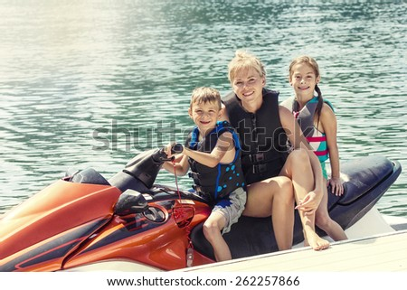 People enjoying a ride on a personal watercraft  - stock photo