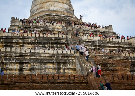 People enjoying a view from pagoda terraces in Bagan, February 14, 2013 - stock photo