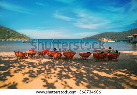 People enjoying the beautiful  beach  and sea in Koh Rong Samloem , Cambodia  - stock photo