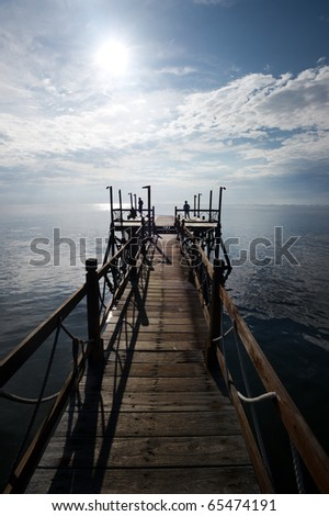 people enjoying view from dock - stock photo