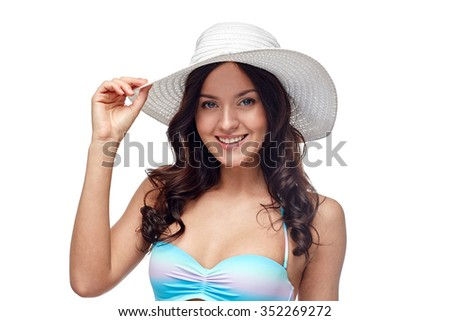 people, fashion, summer and beach concept - happy young woman in bikini swimsuit and sun hat