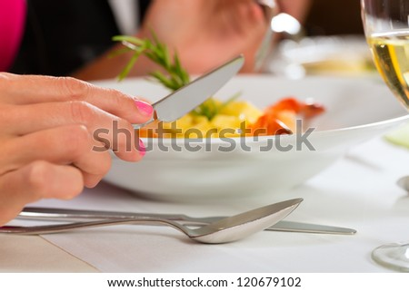 People fine dining food at table in hotel or elegant restaurant - stock photo