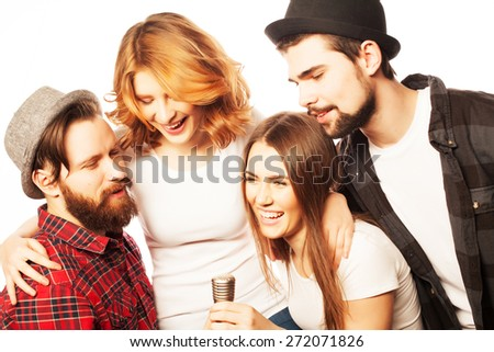People, friendship  and leisure concept: group of young happy friends  having fun at karaoke, hipster style.Isolated on white. - stock photo