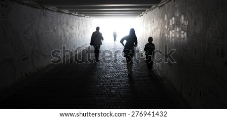 People go through an underpass - stock photo