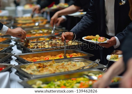people group catering buffet food indoor in luxury restaurant with meat colorful fruits and vegetables - Buffet Retro Cuisine