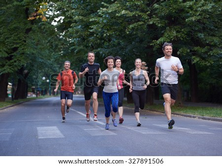 people group jogging, runners team on morning  training - stock photo