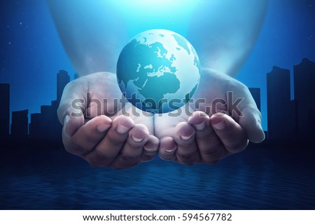 People hand holding floating earth with silhouette cityscape at night. Earth hour concept.