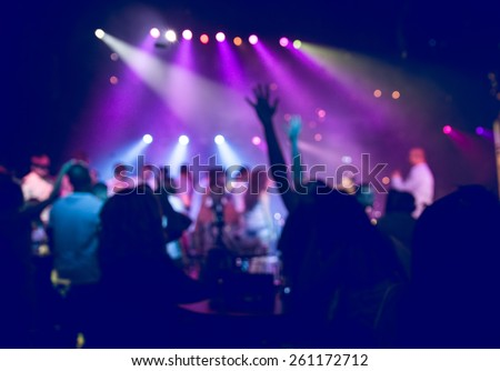 people having fun in a disco. blur effect for an artistic touch - stock photo