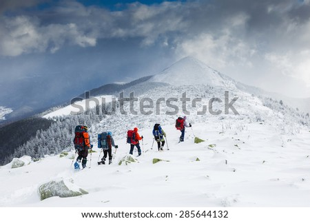 people hiking in beautiful mountain nature landscape - stock photo