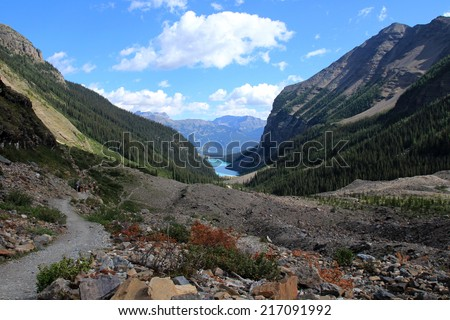 People hiking on the Plain of the Six Glaciers hiking trail near Lake Louise, Banff National Park, Alberta, Canada - stock photo