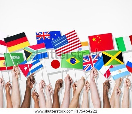 People holding flags of their country. - stock photo