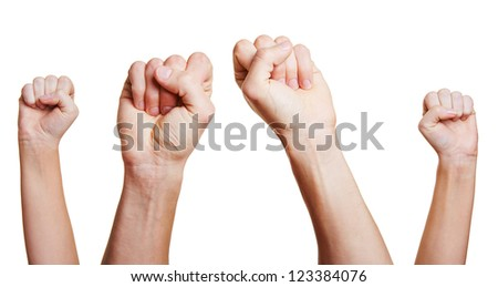 People holding four clenched fists up in the air - stock photo