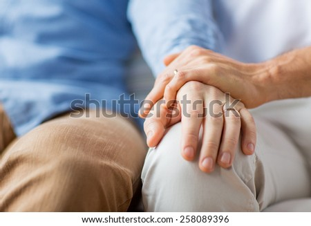 people, homosexuality, same-sex marriage, gay and love concept - close up of happy male gay couple holding hands with wedding rings on - stock photo