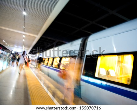 People hurrying to catch a train. blurred motion - stock photo