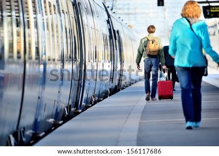 People hurrying to catch train - stock photo