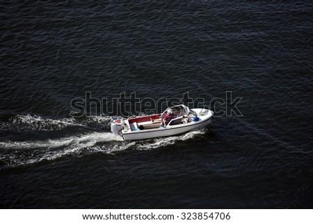 People in a boat with fishing gear on Little Belt in Denmark. - stock photo
