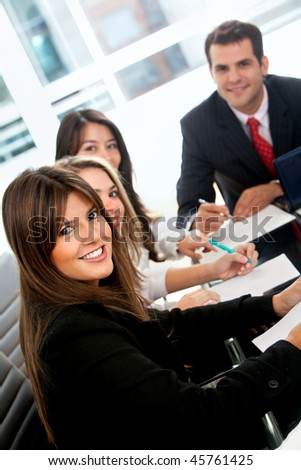 People in a business meeting at the office smiling - stock photo