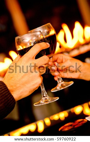 People in a romantic dinner toasting with wine - stock photo