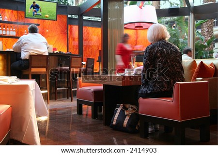 People in a sport bar. Image on tv is my own. - stock photo