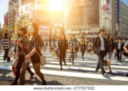 People in bokeh, street downtown view of  Tokyo. - stock photo