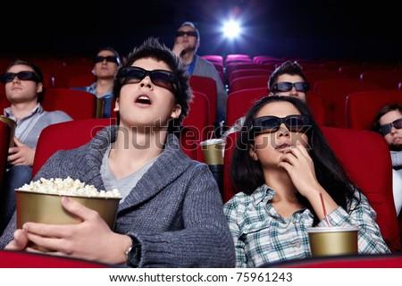 People in 3D glasses in cinema - stock photo