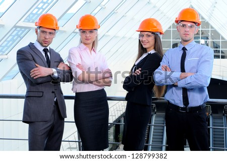 People in helmets on a construction site