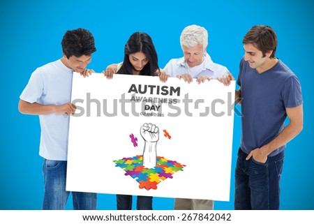 People in jeans holding and watching a big sign against blue background with vignette - stock photo