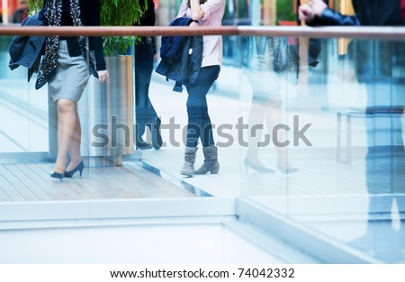 People in rush in a modern shopping mall.