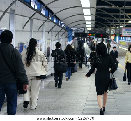 People in subway tunnel - stock photo