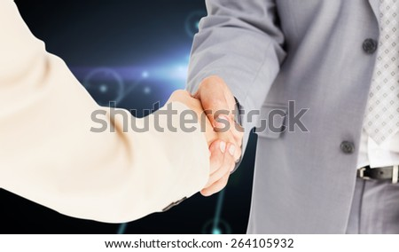 People in suit shaking hands against glowing background with lines - stock photo