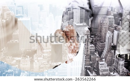 People in suit shaking hands against high angle view of city - stock photo