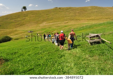 people in summer mountains, tourists - stock photo