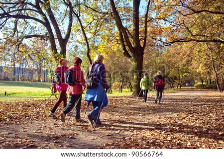 People in the park - Nordic walking - stock photo