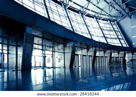 People in wide blue hall window in exposition center, right copmosition - stock photo