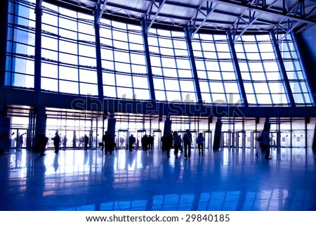 People in wide violet enter hall window in exposition center, left copmosition - stock photo