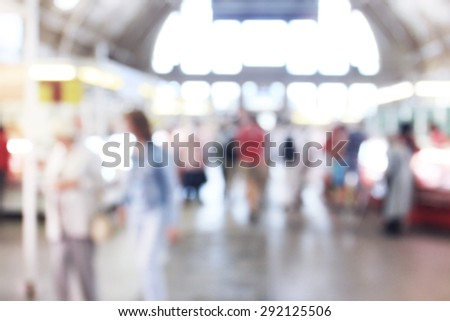 People inside building of market, blurred unrecognizable background - stock photo
