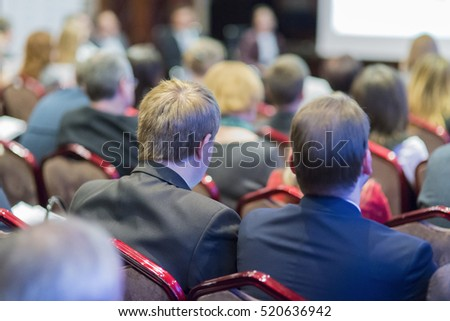 People Listening At the Conference. Back View.Horizontal Image Orientation