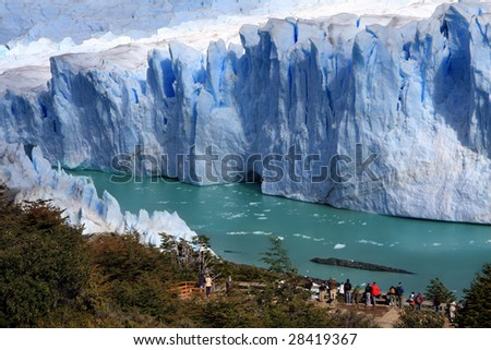 People looking at beautiful Perito Moreno glacier - stock photo