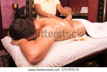 people man engaged in Ayurvedic spa treatment - stock photo