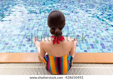 people, meditation, yoga, relax and wellness concept with swimming pool - stock photo