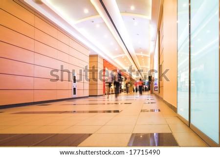 People mooving in hall corridor - stock photo
