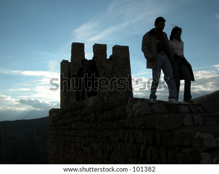 People near the city walls of the medieval town of Albarracin in the province of Teruel, Spain. - stock photo